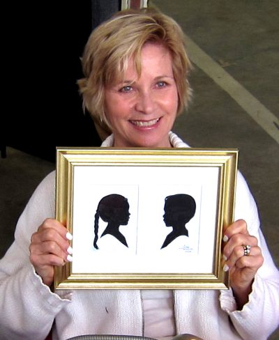 Artist Holding Silhouette of Siblings