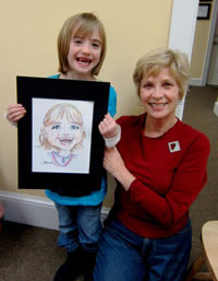 Artist with Young Caricature Subject